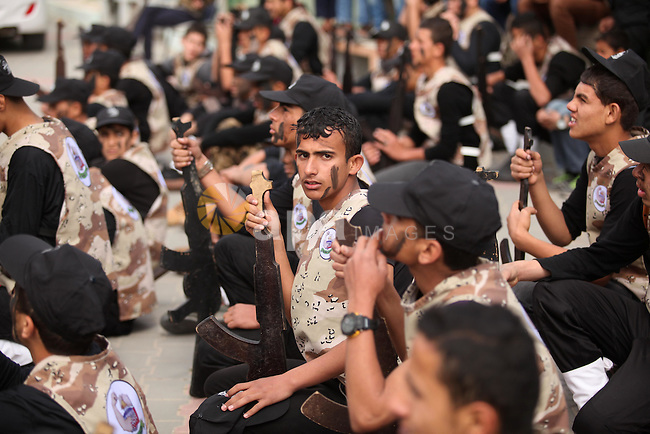 Palestinian students demonstrate their skills during a military-style show at a school in Rafah in the southern Gaza Strip March 28, 2016. Photo by Ashraf Amra