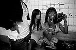Lady K and his girls do a last minute makeup check at the subway station.  He spends most of his nights sneaking into bars and clubs getting other men to pay for drinks and food. They often stay out long past shelter curfews and are forced to go home with strangers rather than spend the night on the street.