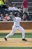 Will Craig (22) of the Wake Forest Demon Deacons follows through on a solo home run leading off the bottom of the 2nd inning against the Miami Hurricanes at Wake Forest Baseball Park on March 21, 2015 in Winston-Salem, North Carolina.  The Hurricanes defeated the Demon Deacons 12-7.  (Brian Westerholt/Four Seam Images)