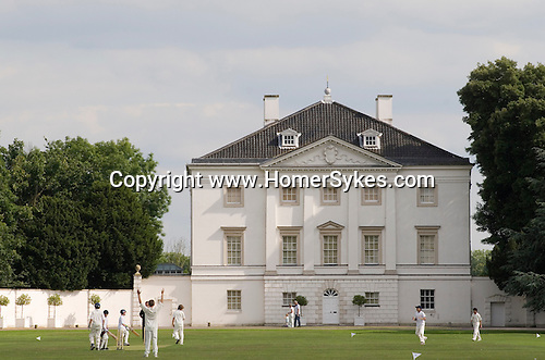 Twickenham Middlesex. England. School children playing cricket in grounds in front of Marble Hill House.