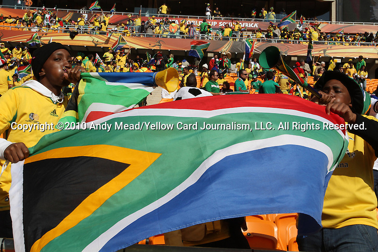 11 JUN 2010: South African fans in the stands of the Soccer City Stadium, pregame. The South Africa National Team played the Mexico National Team at Soccer City Stadium in Johannesburg, South Africa in the opening match of the 2010 FIFA World Cup.