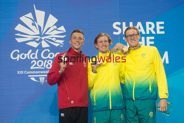 Wales Daniel Jervis celebrates winning Silver in the Mens 1500m Final with Gold medalist Jack Mcloughlin & Bronze medalist Mack Horton<br /> <br /> *This image must be credited to Ian Cook Sportingwales and can only be used in conjunction with this event only*<br /> <br /> 21st Commonwealth Games - Swimming -  Day 6 - 10\04\2018 - Gold Coast Optus Aquatic centre - Gold Coast City - Australia