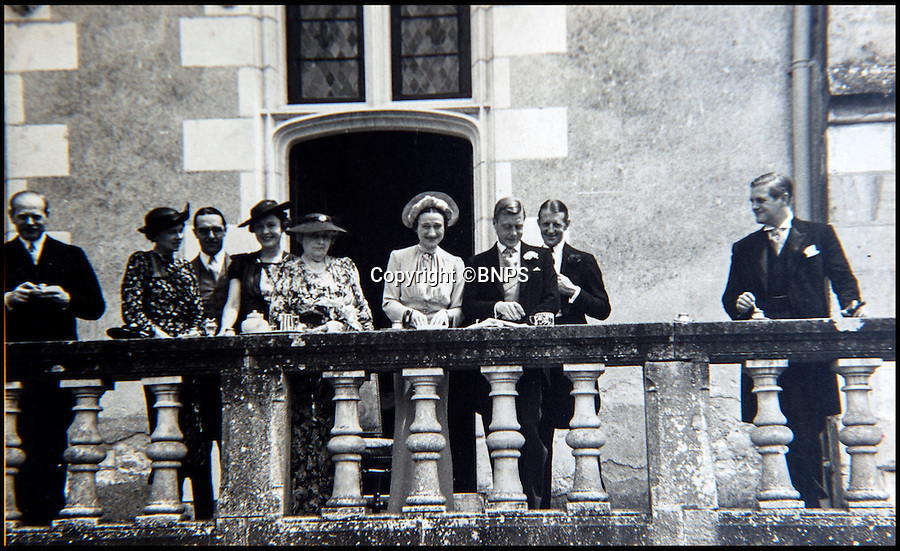 BNPS.co.uk (01202 558833)<br /> Pic: PhilYeomans/BNPS<br /> <br /> Edward and Wallis emerge onto the upper terrace after the ceremony. (Randolph Churchill(right) and Baron Eugene Rothschild(left)<br /> <br /> Previously unseen photographs of the most notorious wedding of the twentieth century have come to light - in a secret album only distributed to the small number of guest's.<br /> <br /> The series of candid photographs from the marriage of Edward VIII to his mistress Wallis Simpson in June 1937 have come to light 80 years after the he sparked a constitutional crisis in Britain.<br /> <br /> The intimate photos were taken by Lady Alexandra Metcalfe, wife of Edward's best man Major Edward 'Fruity' Metcalfe, who had assumed the role of unofficial photographer at the simple ceremony.<br /> <br /> The private pictures were distributed only to the handful of guest's at the Chateau, and this set was given to W. Cunningham Graham, the British consul at Nante.<br /> <br /> They show how Edward's marriage to Wallis Simpson was in stark contrast to the opulent weddings that Royal Family members are usually afforded.<br /> <br /> Bellmans auctioneers in Billingshurst, West Sussex are selling the fascinating album on 30th November.