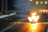 Oct. 28 2011; Las Vegas, NV, USA: NHRA top fuel dragster driver T.J. Zizzo has an engine explode in flames during qualifying for the Big O Tires Nationals at The Strip at Las Vegas Motor Speedway. Mandatory Credit: Mark J. Rebilas-US PRESSWIRE