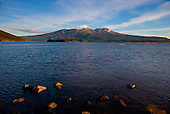 Looking across Lake Rotoaira to Mount Tongariro. Steam from the Ketetahi Hot Springs can be seen to the right, Central North Island, New Zealand
