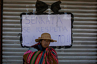 "An indigenous woman stands in front of a sign with a handwritten message that reads in Spanish: ""Senkata must be respected, dammed"" during a demonstration on streets after the killing of at least nine people reported during clashes with security forces the day before in El Alto, on the outskirts of La Paz, Bolivia. Popular unrest has spread out across the country since Morales resigned on November 10 under pressure of the military while his supporters call for a national uprising against the interim government. November 20, 2019.<br /> Une femme indigène se tient devant une pancarte avec un message manuscrit en espagnol : ""Senkata doit être respecté, damné"" lors d'une manifestation dans les rues après le meurtre d'au moins neuf personnes signalé lors d'affrontements avec les forces de sécurité la veille à El Alto, à la périphérie de La Paz, en Bolivie. Les troubles populaires se sont étendus à tout le pays depuis que Morales a démissionné le 10 novembre sous la pression des militaires, tandis que ses partisans appellent à un soulèvement national contre le gouvernement intérimaire. 20 novembre 2019."