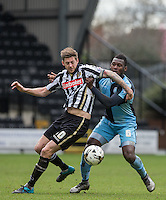 Aaron Pierre of Wycombe Wanderers & Jonathan Stead of Notts County battle for the ball during the Sky Bet League 2 match between Notts County and Wycombe Wanderers at Meadow Lane, Nottingham, England on 28 March 2016. Photo by Andy Rowland.