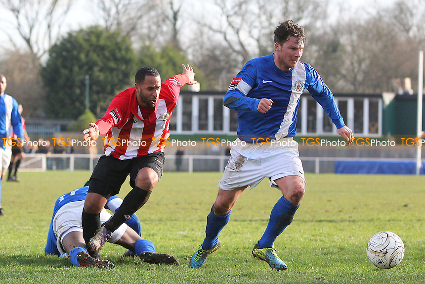 Kenny Beaney of Grays eveades Michael Spencer of Hornchurch - AFC Hornchurch vs Grays Athletic - Ryman League Premier Division Football at The Stadium, Bridge Avenue - 01/03/14 - MANDATORY CREDIT: Gavin Ellis/TGSPHOTO - Self billing applies where appropriate - 0845 094 6026 - contact@tgsphoto.co.uk - NO UNPAID USE