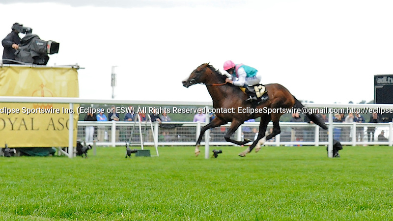 Sea Moon (no. 12), ridden by Ryan Moore and trained by Sir Michael Stoute, wins the group 2 Hardwicke Stakes for four year olds and upward on June 23, 2012 at Ascot Racecourse in Ascot, England.  (Bob Mayberger/Eclipse Sportswire)