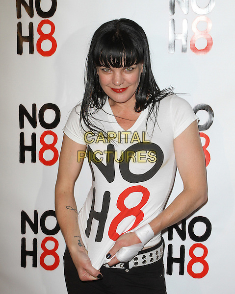 Pauley Perrette.NOH8's 3 year Anniversary Celebration Held At The House of Blues, West Hollywood, California, USA..December 13th, 2011.half length black white t-shirt belt bandage hand.CAP/ADM/KB.©Kevan Brooks/AdMedia/Capital Pictures.