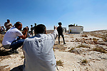 Palestinian protesters argue with Israeli border police as the Israeli army removes containers used as a school, near the West Bank city of Hebron on July 11, 2018. Photo by Wisam Hashlamoun