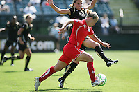 Lori Lindsey fights to maintain possession.  Washington Freedom defeated FC Gold Pride 4-3 at Buck Shaw Stadium in Santa Clara, California on April 26, 2009.