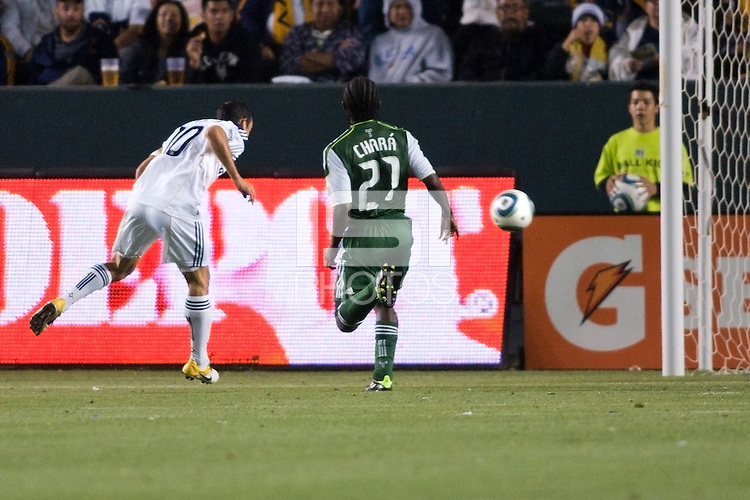 LA Galaxy midfielder Landon Donovan (10) scores his second goal of the game on a crossing ball head shot from Juan Pablo Angel. The LA Galaxy defeated the Portland Timbers 3-0 at Home Depot Center stadium in Carson, California on  April  23, 2011....