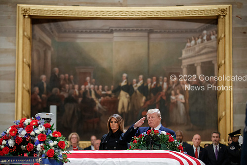 US President Donald J. Trump, with First Lady Melania Trump, salutes the casket containing the body of former US President George H.W. Bush in the Rotunda of the US Capitol in Washington, DC, USA, 03 December 2018. Bush, the 41st President of the United States (1989-1993), died in his Houston, Texas, USA, home surrounded by family and friends on 03 November 2018. The body will Lie in State in the Capitol before being moved to the Washington National Cathedral for a funeral service. It will then return to Houston for another funeral service before being transported by train to the George Bush Presidential Library and Museum for internment.