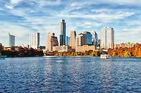 "Another great photo of the Austin skyline from the shore of Ladybird lake on this great fall day.  Austin is home to the State Capital and the city is growing at leaps and bounds many of these downtown high rises skyscrapers were not here ten years ago most have gone up in the last five years. In this cityscape photo we capture beautiful fall colors on  this December day with the tree displaying fall colors all along the hike and bike trail with one of the paddle boat on the water full of tourist enjoying a nice day on Ladybird Lake and a lovely city view. The skyline of Austin is always changing and the downtown area has many new residences who live in the city so it is a very active place with many restaurants, several parks, hike and bike trails, the warehouse district night life and of course six street where the term ""Live Music Capital"" came from. Sometimes living in Austin for locals can be difficult, because there is always something going on so a lazy walk down the trails may turn in to a fight for a parking space, but for those that live in the city it just a heart beat away."