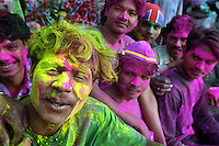 Young men covered in coloured powder along the Grand Trunk Road in Delhi. The important Hindu festival of Holi (also known as the festival of colours) celebrates the coming of spring.