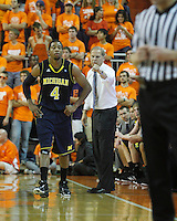 Nov 30, 2010; Clemson, SC, USA; Michigan Wolverines head coach Brad Brownwell gives instructions to guard Demontez Stitt (4) in the game against the Clemson Tigers at Littlejohn Coliseum. Mandatory Credit: Daniel Shirey/WM Photo -US PRESSWIRE