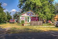 "The ""Redneck Castle"" is home to Harley and Annabelle Russell, owners of the Sandhills Curiosity Shop on Route 66 in Erick Oklahoma is indeed a curiosity.  Harley and Annabelle Russell the ""Mediocre Music Makers"" perform and entertain travelers on Route 66 with there singing and antics.  They have a store full of memorabilia, but don't have anything for sale, only for the enjoyment of those who stop to visit."