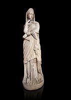 Roman statue of Nemesis goddess of  retribution.Marble. Perge. 2nd century AD. Inv no 6.29.81 .Antalya Archaeology Museum; Turkey. Against a black background.