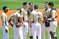 18 March 2012:  FIU's infielders (pictured, from left to right, Julius Gaines (2), David Vazquez (4), John Costa (22), Tyler James Shantz (5), Mike Martinez (40) and Aramis Garcia (44)) gather at the mound to speak with Assistant Coach Drew French as the Florida Atlantic University Owls defeated the FIU Golden Panthers, 9-3, at University Park in Miami, Florida.