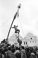 Afghans scramble to touch a pole flying a symbolic flag during Norouz celebrations, which marks the spring equinox and the start of the New Year, in Kabul, Afghanistan on March 21, 1989. The ancient holiday dates back to Zoroastrian times.
