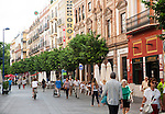 Busy pedestrianised shopping street, Calle San Jacinto, Triana, city of Seville, Spain