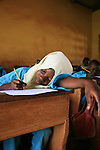 A pupil from the Islamic school in Sunyani, Ghana, working on her exam. In Ghana, coranic schools were transformed into islamic schools. Pupils learn the mainstream curriculum and have additional courses in arabic and islam.