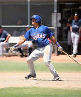 Jorge Alfaro #11 of the Texas Rangers plays in an extended spring training game against the Seattle Mariners at the Mariners complex on April 30, 2011  in Peoria, Arizona. .Photo by:  Bill Mitchell/Four Seam Images.