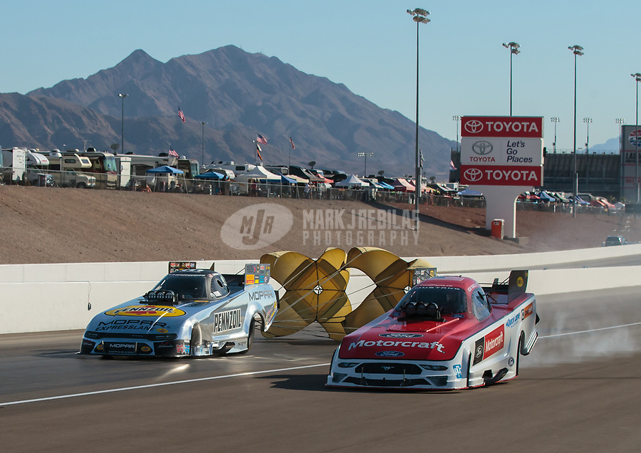 Oct 26, 2018; Las Vegas, NV, USA; NHRA funny car driver Matt Hagan (left) alongside Bob Tasca III during qualifying for the Toyota Nationals at The Strip at Las Vegas Motor Speedway. Mandatory Credit: Mark J. Rebilas-USA TODAY Sports