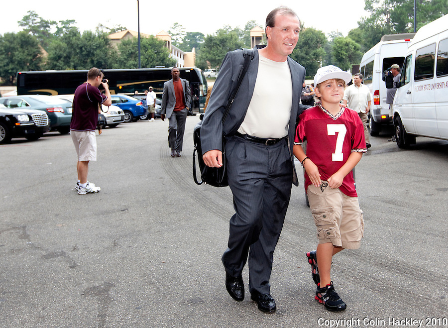 TALLAHASSEE, FL 9/4/10-FSU-SAMFORD FB10 CH-Florida State Head Coach Jimbo Fisher and son Trey leave the team bus and to prepare for the game against Samford Saturday at Doak Campbell Stadium in Tallahassee. The Seminoles beat the Bulldogs 59-6 to give Head Coach Jimbo Fisher his first victory..COLIN HACKLEY PHOTO