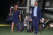 Donald J. Trump, Jr. and Kimberly Guilfoyle walk on the South Lawn of the White House as the arrive with President Donald Trump after a trip to Cincinnati on August 1, 2019 in Washington, DC. <br /> Credit: Oliver Contreras / Pool via CNP