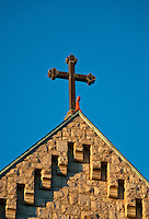 Christian cross at the apex of a church building.