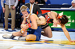 BROOKINGS, SD - NOVEMBER 17: Rylee Molitor from South Dakota State University controls the leg of Kaid Brock from Oklahoma State University during their 141 pound match Saturday night at Frost Arena in Brookings. (Photo by Dave Eggen/Inertia)