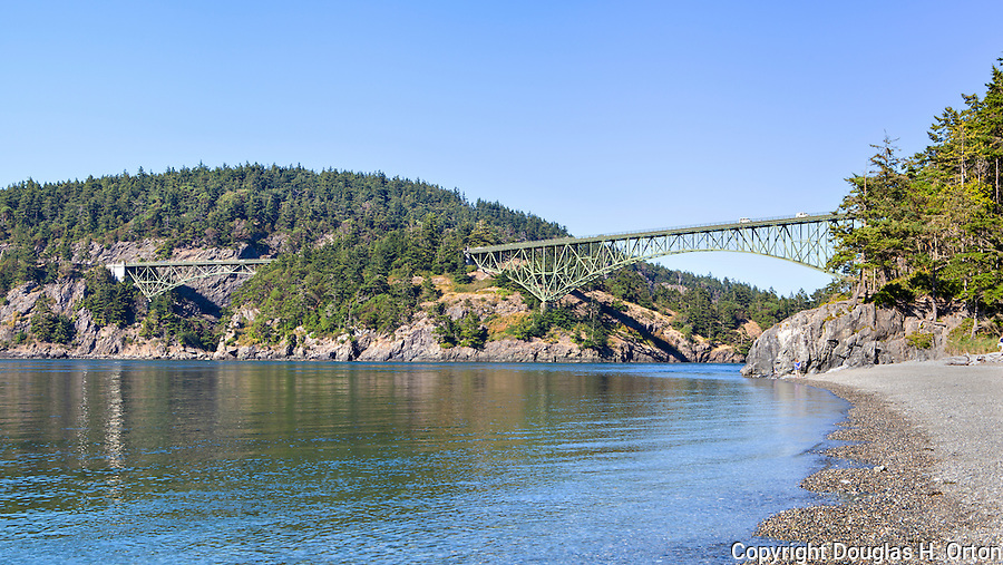 World famous Deception Pass Bridge seen from North Beach in Deception Pass State Park, Washington, USA.  The bridge connects Fidalgo and Whidbey Islands in Puget Sound via Washington State Highway Route 20 near the towns of Anacortes and Oak Harbor.