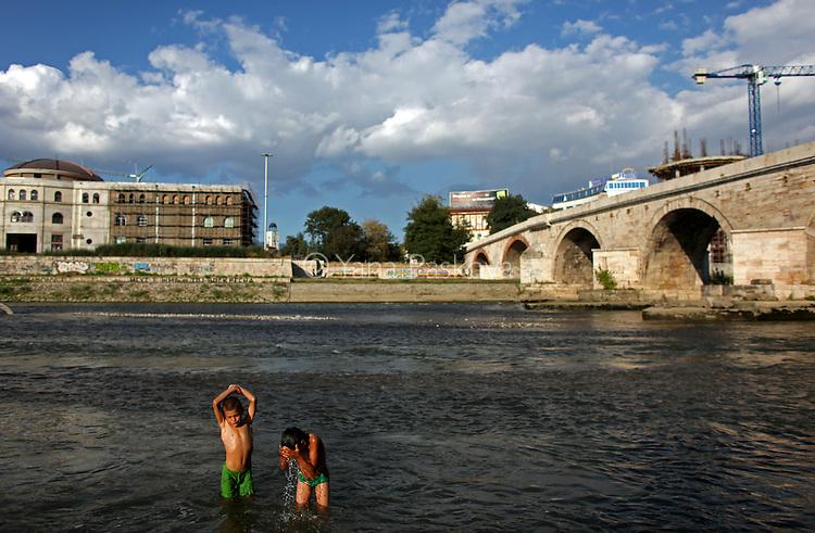 (L-R) Two Macedonian gypsy boys, Elis and Martin, swim in the river Vardar near the Stone Bridge in Skopje, Macedonia on Sunday, September 05, 2010.