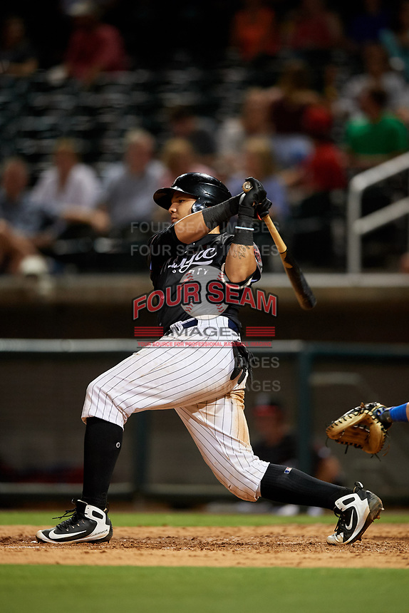 Birmingham Barons catcher Alfredo Gonzalez (1) follows through on a swing during a game against the Tennessee Smokies on August 16, 2018 at Regions FIeld in Birmingham, Alabama.  Tennessee defeated Birmingham 11-1.  (Mike Janes/Four Seam Images)
