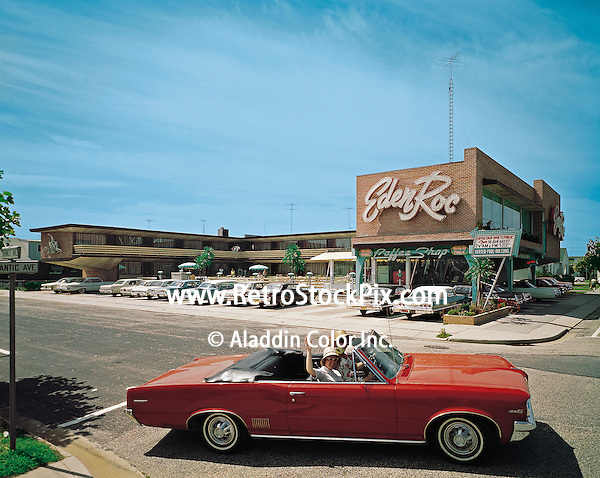 Eden Roc Motel, Wildwood, New Jersey. Ladies waving from a convertable in front of the motel. 1960's photograph.
