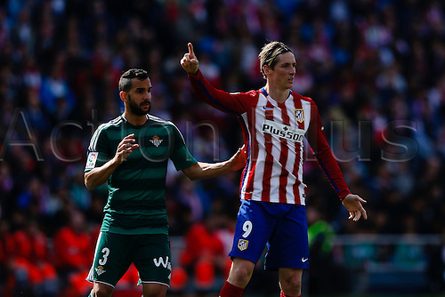02.04.2016. Madrid, Spain.  Fernando Torres (9) Atletico de Madrid covered by Martin Montoya (3) Real Betis. La Liga match between Atletico de Madrid and Real Betis at the Vicente Calderon stadium in Madrid, Spain, April 2, 2016 .