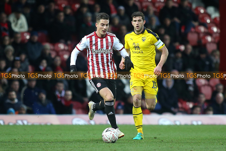 Sergi Canos of Brentford in possession as Oxford's John Mousinho looks on during Brentford vs Oxford United, Emirates FA Cup Football at Griffin Park on 5th January 2019