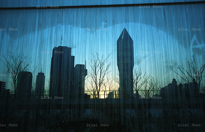 Image of downtown Shnanghai is reflected in a glass panel in Shanghai, China in December, 2008.  .