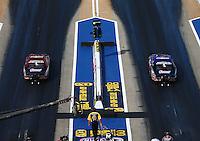 Jun 17, 2016; Bristol, TN, USA; NHRA pro stock driver Greg Anderson (left) races alongside teammate Jason Line during qualifying for the Thunder Valley Nationals at Bristol Dragway. Mandatory Credit: Mark J. Rebilas-USA TODAY Sports