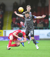 Swindon Town's Jak McCourt is fouled by Lincoln City's Lee Frecklington<br /> <br /> Photographer Andrew Vaughan/CameraSport<br /> <br /> The EFL Sky Bet League Two - Swindon Town v Lincoln City - Saturday 12th January 2019 - County Ground - Swindon<br /> <br /> World Copyright © 2019 CameraSport. All rights reserved. 43 Linden Ave. Countesthorpe. Leicester. England. LE8 5PG - Tel: +44 (0) 116 277 4147 - admin@camerasport.com - www.camerasport.com