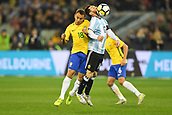 June 9th 2017, Melbourne Cricket Ground, Melbourne, Australia; International Football Friendly; Brazil versus Argentina; Marcio Rafael Souza of Brazil collides with Lionel Messi of Argentina as they contest for the high ball