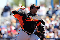 Baltimore Orioles pitcher Alfredo Simon #55 delivers a pitch during a spring training game against the Tampa Bay Rays at the Charlotte County Sports Park on March 5, 2012 in Port Charlotte, Florida.  (Mike Janes/Four Seam Images)
