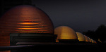 At night, domed light fixtures designed by Frank Lloyd Wright for the Monona Terrace Roof Garden glow with a wonderful orange light.