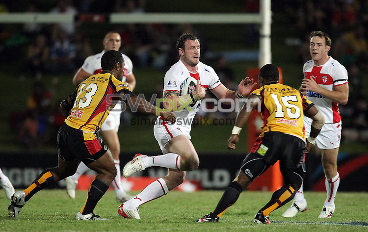 PICTURE BY VAUGHN RIDLEY/SWPIX.COM - Rugby League - Rugby League World Cup 2008 - England v Papua New Guinea - Dairy Farmers Stadium, Townsville, Australia - 25/10/08...Copyright - Simon Wilkinson - 07811267706...England's Jamie Peacock, PNG's Rod Griffin and George Moni.