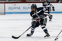 BOSTON, MA - FEBRUARY 16: Tamara Thierus #18 of University of New Hampshire brings the puck forward during a game between University of New Hampshire and Boston University at Walter Brown Arena on February 16, 2020 in Boston, Massachusetts.