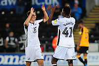 Jordon Garrick (R) of Swansea City celebrates scoring his side's third goal with team mate Tom Carroll (L)during the Carabao Cup Second Round match between Swansea City and Cambridge United at the Liberty Stadium in Swansea, Wales, UK. Wednesday 28, August 2019.