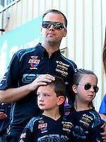 Jul. 20, 2014; Morrison, CO, USA; NHRA pro stock driver Jonathan Gray and his children during the Mile High Nationals at Bandimere Speedway. Mandatory Credit: Mark J. Rebilas-