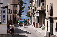 peloton rolling through town<br /> <br /> Stage 2: Benidorm to Calpe (199.6km)<br /> La Vuelta 2019<br /> <br /> ©kramon
